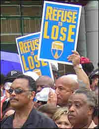 Rev. Jesse Jackson and Rev. Al Sharpton lead the march.
