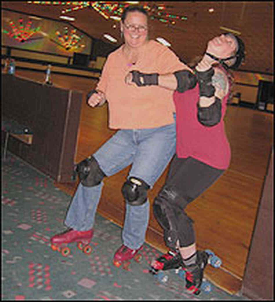 Debbie Elliott pretends to elbow a Charm City Roller Girl.