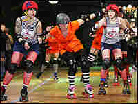 A jammer tries to break through two blockers in Gotham Girls Roller Derby action in the Bronx, N.Y.