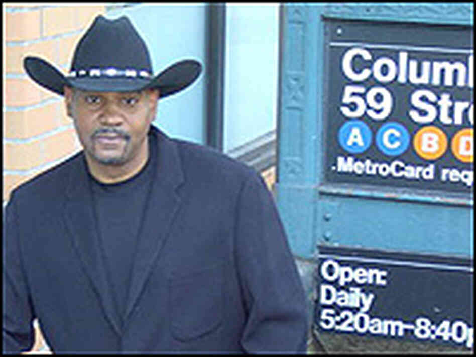 Allan Harris, in cowboy hat, outside a NYC subway station.