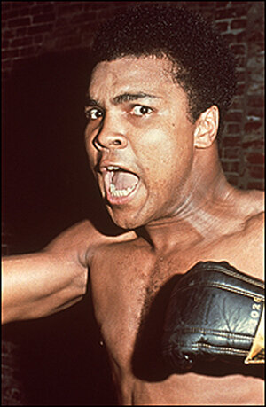 A 1963 photo finds Muhammad Ali in a familar pose, shouting at the camera.