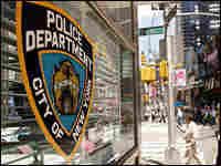 Above, the Times Square police office in New York City.