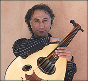 Rahim Al Haj with his oud, a large stringed instrument.