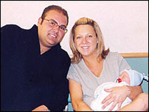 Jenifer and Angelo Magliocco with their first son, Angelo James.