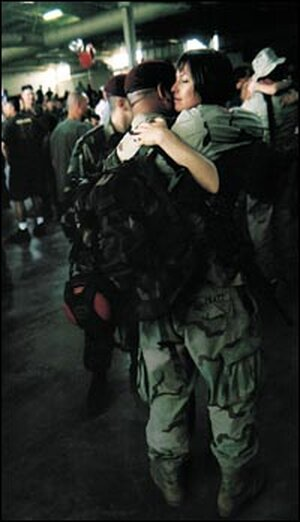 Army Pvt. Luigi Pratt and his wife Beth at his homecoming at Pope Air Force Base.