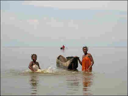 Women bathing in Lake Upemba.