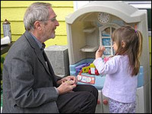 Analia Reutter plays with Professor Howard Mielke in her backyard.