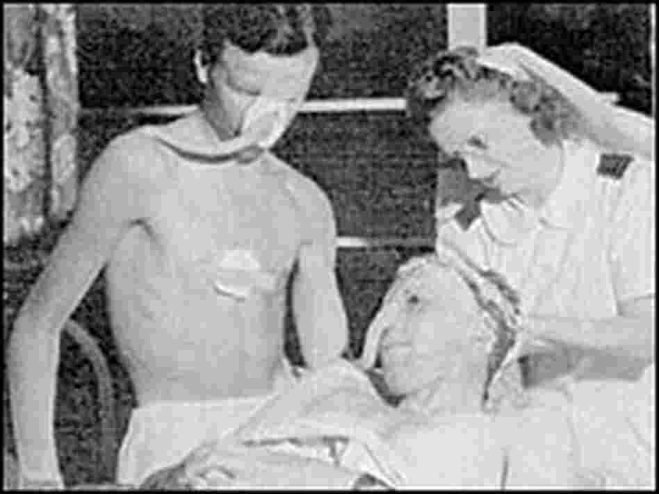 Bill Foxley (standing) in the second stage of his skin graft.