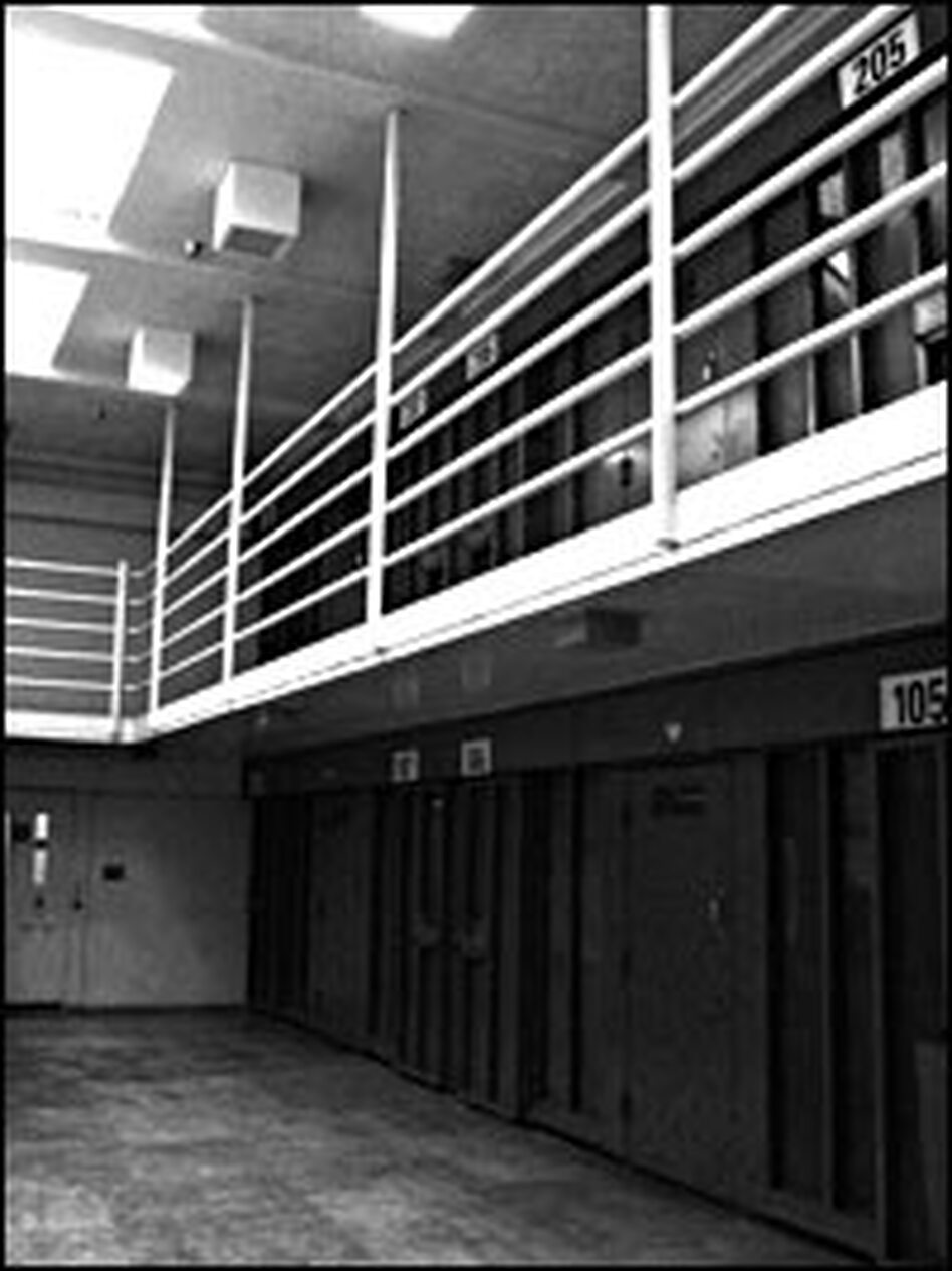 "A view of the hallway in a ""pod"" at Pelican Bay. Each hallway houses eight cells. Each pod has six hallways. There are 132 such hallways at the prison."