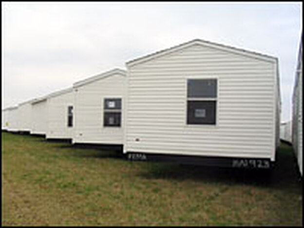 FEMA mobile homes stockpiled at the airport in Hope, Ark. FEMA plans to lay down $6 million worth of gravel so the trailers don't sink into the mud.