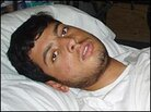 Mohammed Niaz lies in a hospital bed.