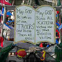 A sign on a fishing boat asks God to bless Katrina victims and U.S. troops.