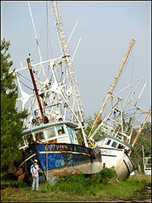 Two boats stranded inland by Hurricane Katrina.