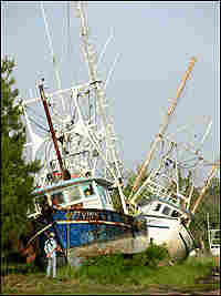 Two boats stranded inland by Hurricane Katrina.