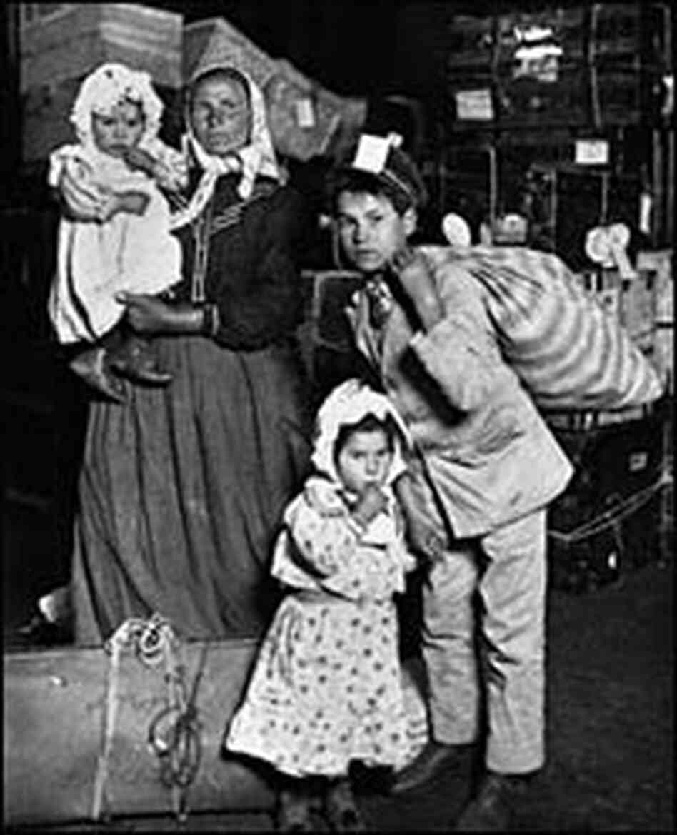 An Italian woman and her children arrive at Ellis Island, New York in 1905.