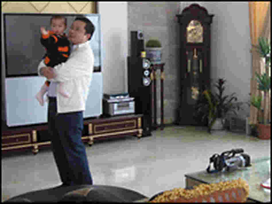 Sun Haiyan with his son in his opulent Huaxi home.