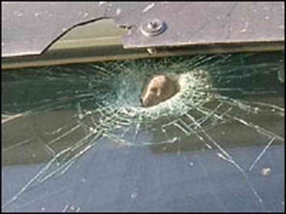 Rock lodged in a truck's windshield.