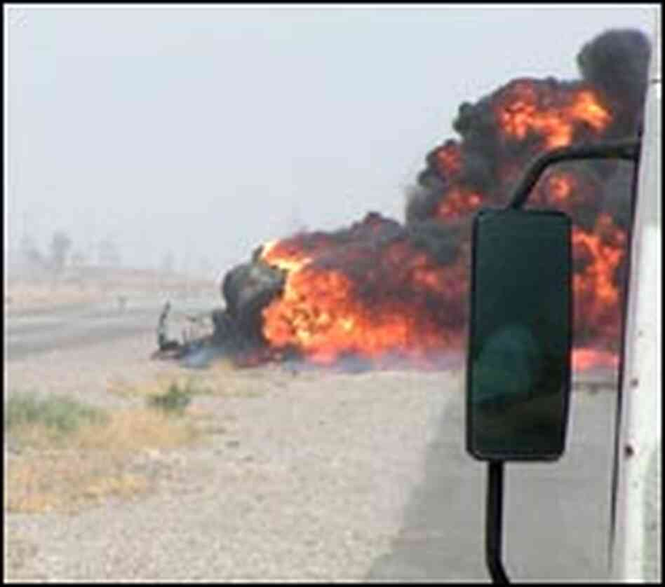 A truck burns after hitting an IED.