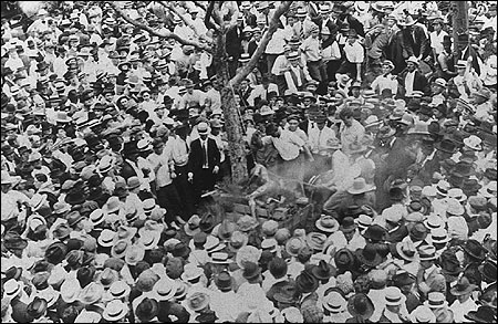 A mob gathers around to watch the lynching of Jesse Washington.