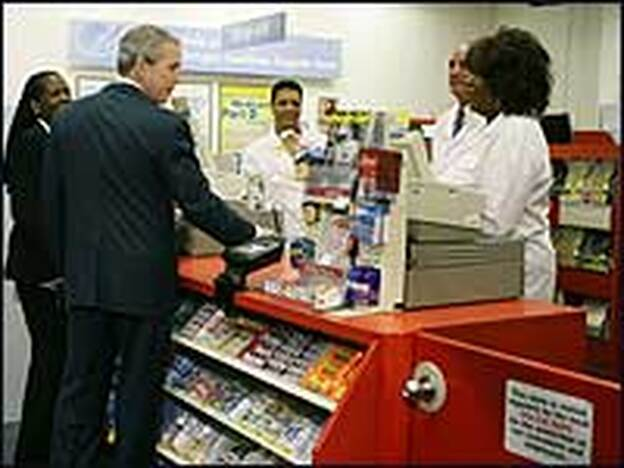 President George Bush last month at a CVS Pharmacy counter in Washington, D.C., during a stop to talk about his administration's Medicare prescription drug initiative.