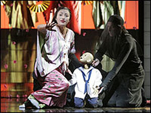 Cristina Gallardo-Domas as Cio-Cio-San, with her puppet son in Madama Butterfly