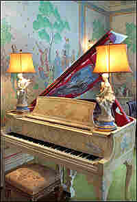 A Steinway piano, painted with vines, was used by Noel Coward.