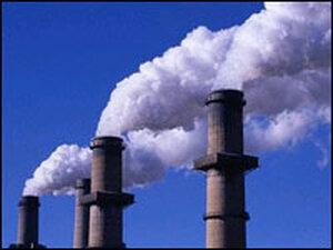 Smokestacks emit steam at a coal-burning power plant.