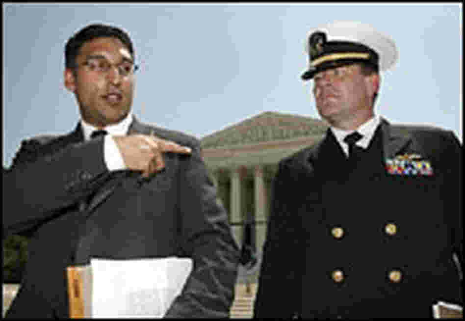 Neal Katyal and U.S. Navy Lt. Cmdr. Charles Swift appear outside the Supreme Court building.