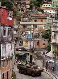 Brazilian soldiers patrol the Rocinha favela in Rio de Janeiro, March 2006.
