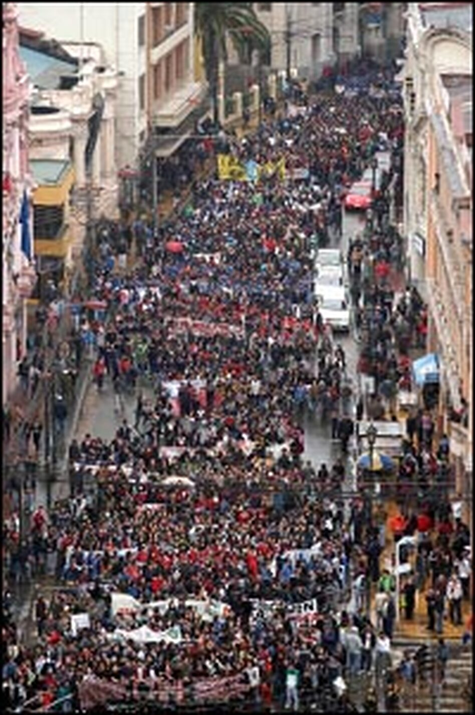 Thousands of Chilean students march during a massive protest rally in the streets of Valparaiso on June 5, 2006 -- part of a nationwide strike to demand education reforms.