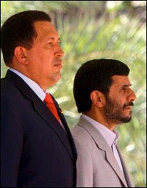 Hugo Chavez, left, stands with Iranian President Mahmoud Ahmadinejad