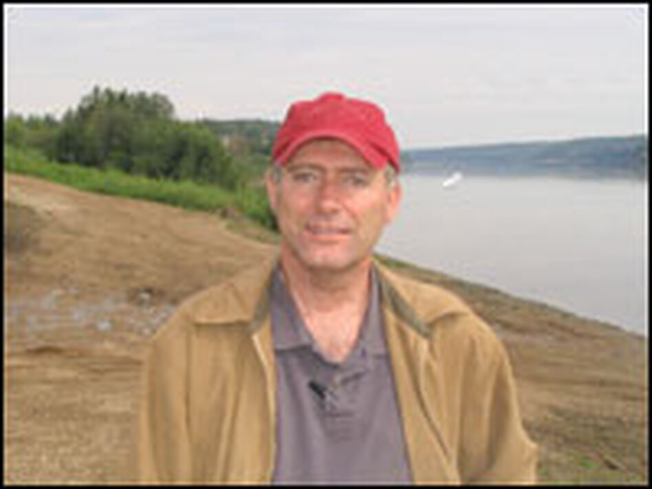 Neil Camarta stands on the banks of the Athabasca River, which runs through Alberta's oil sands. Camarta, who runs Petro-Canada's oil-sands project, says his company will probably build an airstrip to fly workers in.