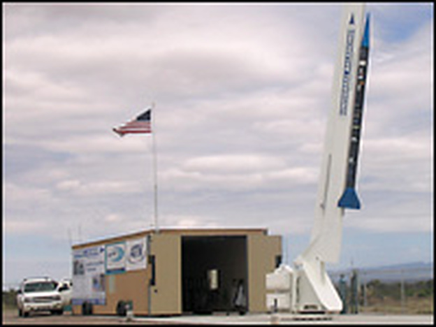 The 20-foot SpaceLoft XL rocket, built by UP Aerospace Inc., sits on a much larger launch arm at Spaceport America's desert home, about 35 miles north of Las Cruces, N.M.