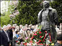 Some 1,000 people gather near a statue of Josip Broz Tito