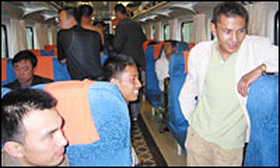 Chinese laborers and businessmen pay about $45 for a simple seat on the train to Tibet.