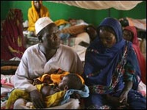 Sudanese refugee Zakariya Hasan holds his son Phartuz at a local hospital in Chad.
