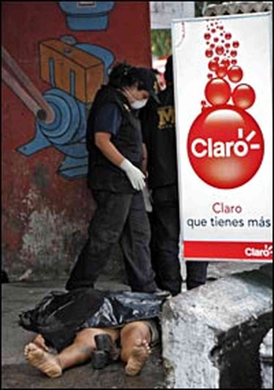 A public ministry officer looks at a murdered woman in Guatemala City in September 2006.