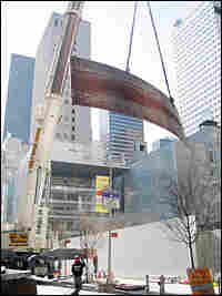 Richard Serra's massive, 100-ton steel sculpture, 'Intersection II', is lifted over the Museu