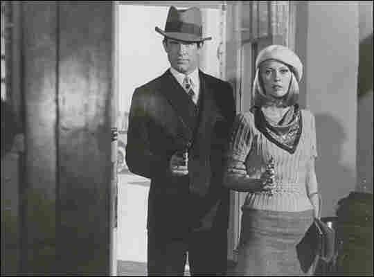Faye Dunaway and Warren Beatty draw guns in a bank.