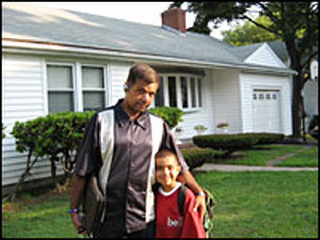 Jose Pomales and his 7-year-old son, Jordan, stand outside of their home in Hyde Park, a Boston neighborhood. They have lived there for 8 years, but two years after refinancing, Pomales is in danger of foreclosure.