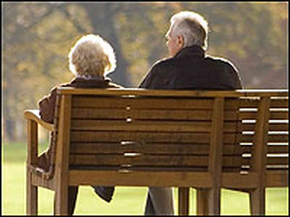 And older couple sitting on a park bench./iStockphoto.com
