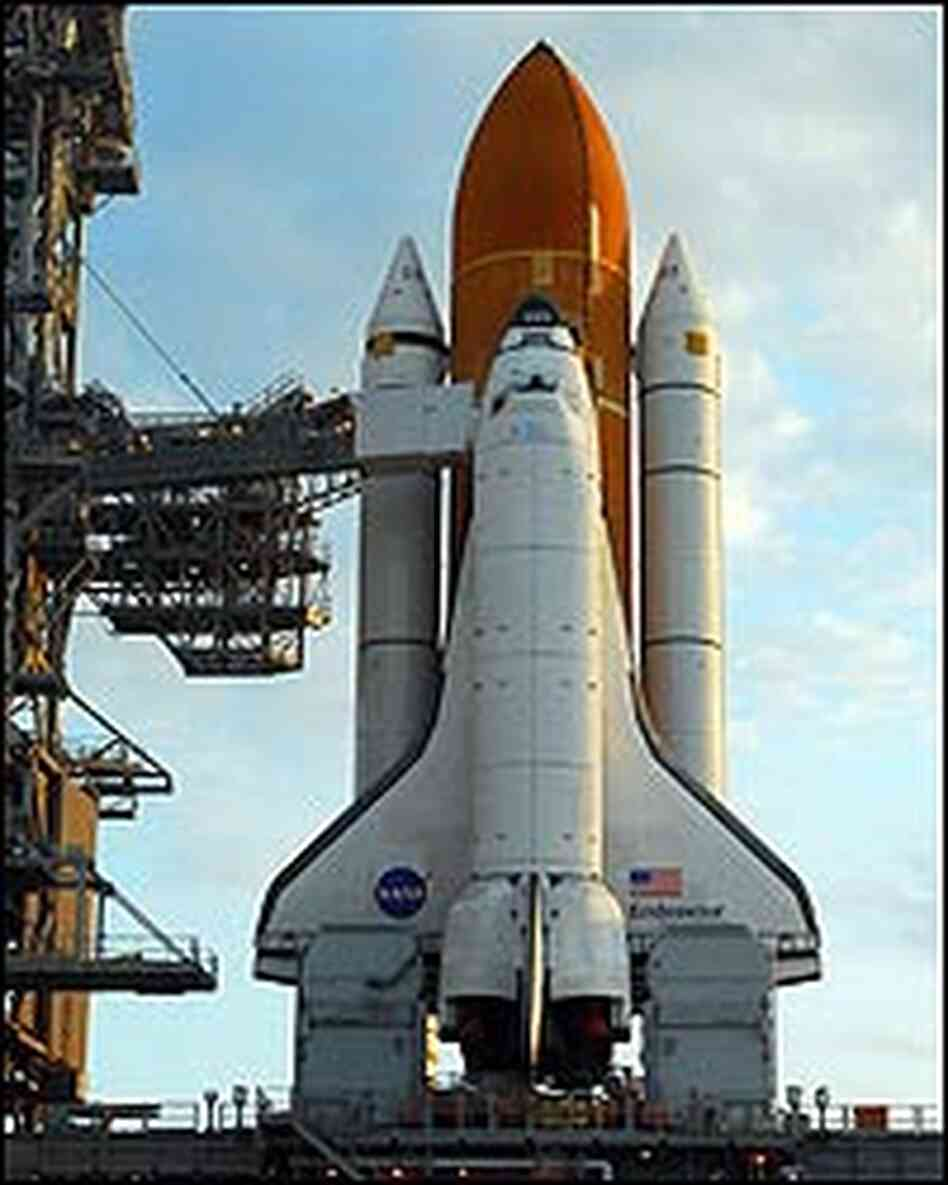 Space shuttle Endeavour sitting on the lauch pad in Florida.