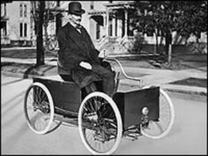 Henry Ford in his first automobile.