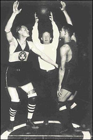 First Jump Ball Between a White Man and a Black man