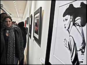 A woman views a drawing in the Honfleur Gallery in Anacostia.