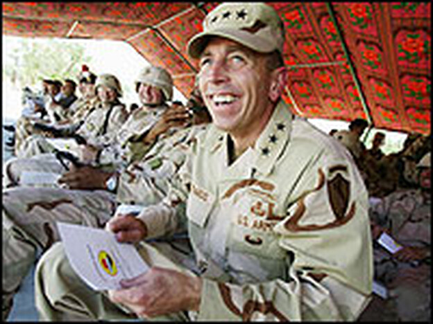 Lt. Gen. David Petraeus visits a coalition base in Tikrit, Iraq, in June 2004. (Brent Stirton/Getty Images)