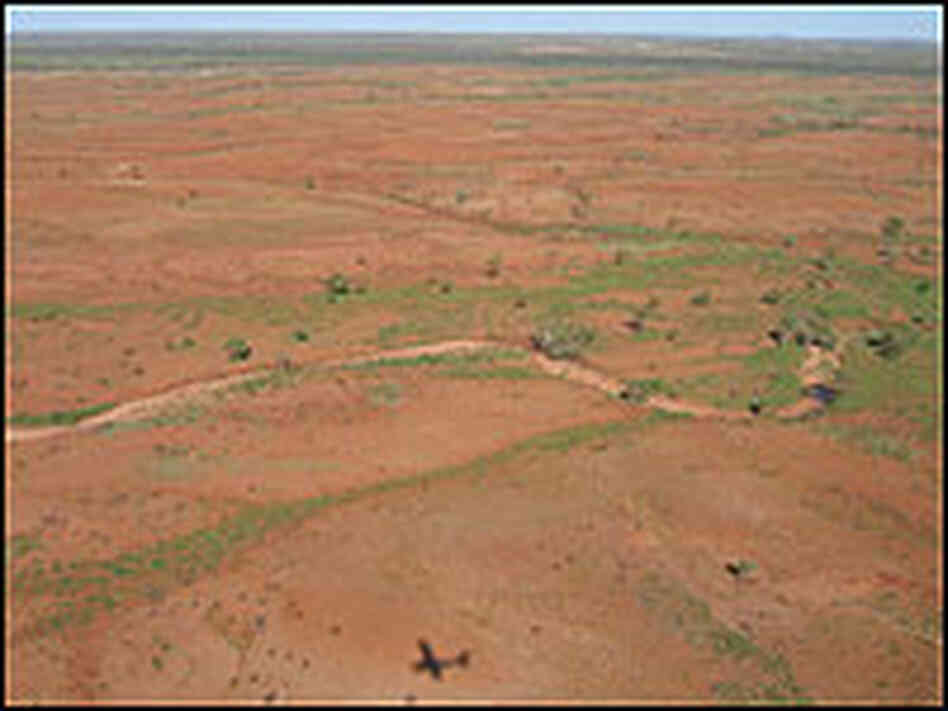An aerial view of the red-clay terrain of the Warrawagine Station.