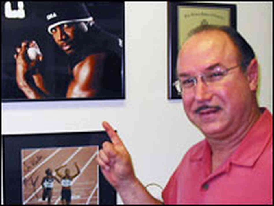 Victor Conte pointing to a photo