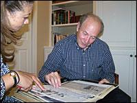 Michele Norris looks through a scrapbook with Bernard Cohen
