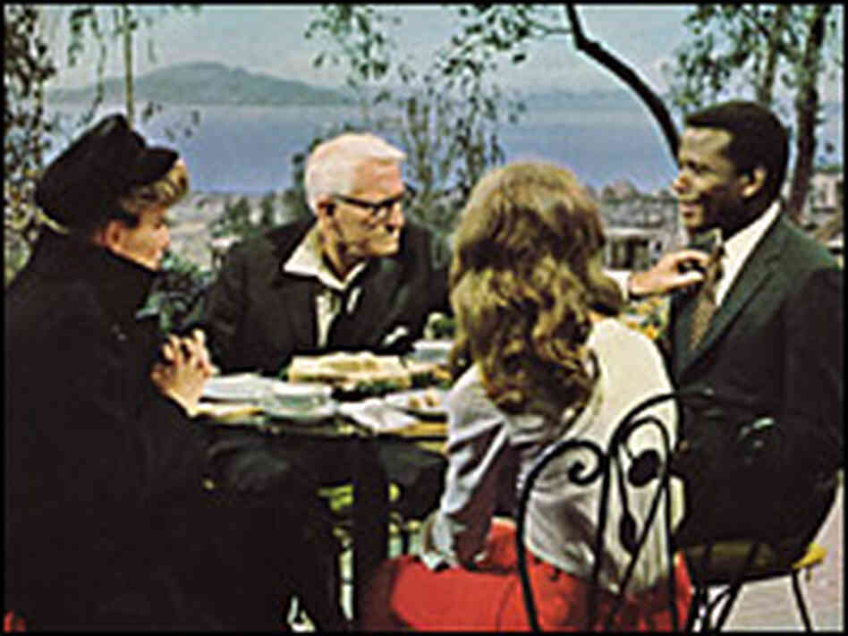Katharine Hepburn, Spencer Tracy, Katharine Houghton and Sidney Poitier at a dinner table